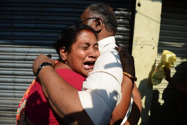 Relatives of victims of a bus accident react after receiving news from police outside the private bus operator's office in Hyderabad, India.