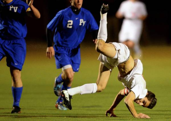 Parkland's Belal Mohamed tumbles as he goes for the ball in the District 11 3A semifinals against Pleasant Valley.