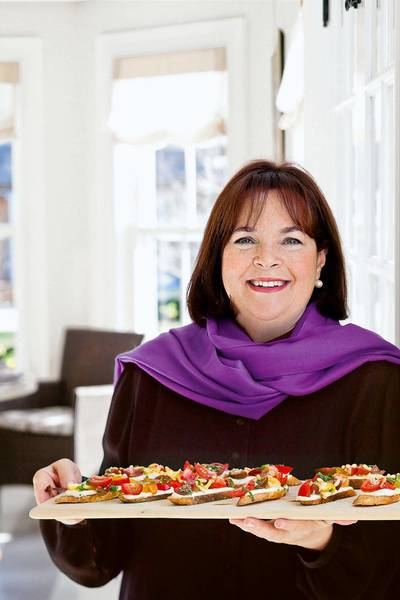 Celebrity chef Ina Garten, host of the Food Network program 'Barefoot Contessa,' holds tomato crostini with whipped feta, a recipe featured in her 2012 book 'Barefoot Contessa Foolproof.'