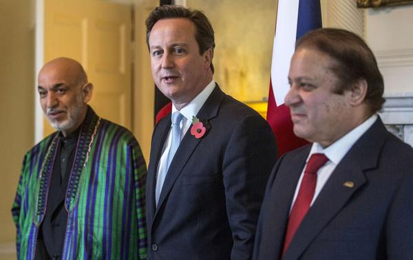 British Prime Minister David Cameron, center, Afghan President Hamid Karzai, left, and Pakistani Premier Nawaz Sharif pose for pictures ahead of a trilateral meeting in London on Tuesday.