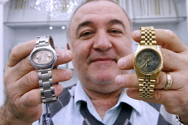 Garo Anserlian, owner of Executive Jewelers, shows a dual time watch with Earth/Mars time at left, and the original Mars time watch that loses about 40 minutes a day, at his watch store in Montrose on Tuesday, Oct. 29, 2013. JPL originally ordered the Mars-time watch for the 2004 Mar rover landing.