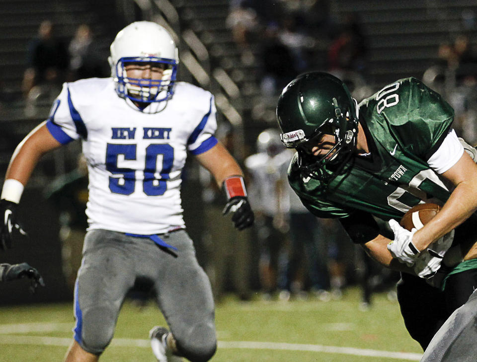 New Kent High School sophomore Jacob Vick, #50, is shown on the left during a football game against Jamestown High. Vick died Tuesday evening after collapsing in practice.