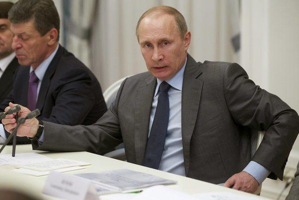 Russian President Vladimir Putin, shown here at a meeting with Olympics organizers at the Black Sea resort of Sochi on Monday, tops this year's Forbes list of the World's Most Powerful people.