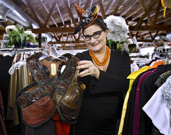 It's A Wrap! Production Wardrobe Sales' Tiara Nappi shows a woman's gladiator top that is available for Halloween at the Burbank store on Tuesday, Oct. 29, 2013.