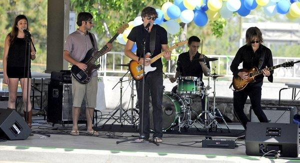 Ryder Buck, center, performs with members of The Ryder Buck Band at Memorial Park in La Canada in 2012. He was killed Sunday after two cars struck him as he stepped out onto the 2 Freeway.