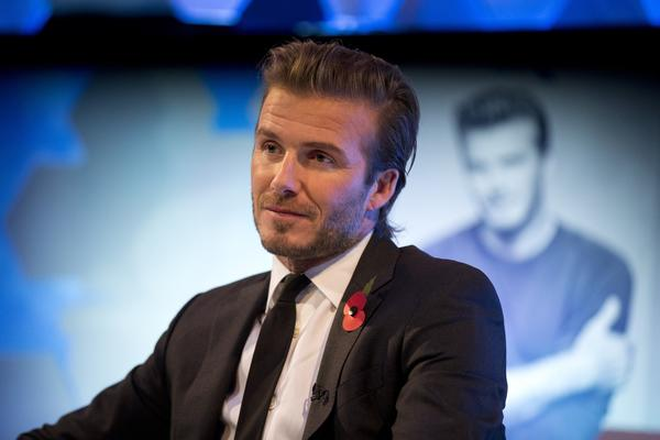 Former Galaxy star David Beckham, shown promoting his new photography book Wednesday in London, hopes to start an MLS expansion team in Miami.