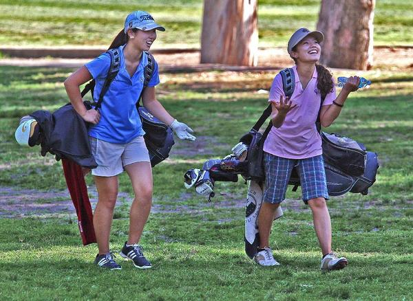 Crescenta Valley High's Andrea Han (left), Laura Perez and their teammates head to Thursday's CIF Southern Section Eastern Team Divisional at 8 a.m. at Jurupa Hills Golf Course in Riverside. (Tim Berger/File Photo)