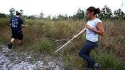 Grieving relatives search brush, homes for bodies of Deltona mom, 2 kids