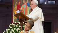 Photos: Boy wanders onto stage with Pope Francis