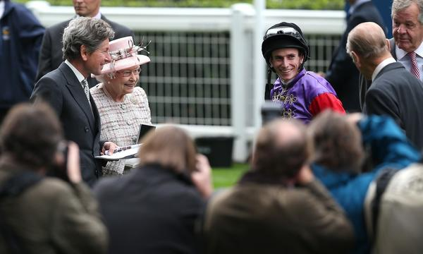 Jockey Ryan Moore, right, speaks with Queen Elizabeth II and Prince Phillip, far right, at Ascot Park in England earlier this month. The accomplished jockey is taking part in the Breeders' Cup at Santa Anita.
