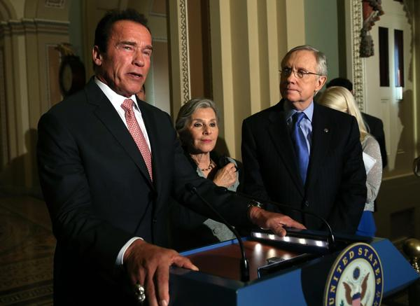 Former California Gov. Arnold Schwarzenegger at a Capitol Hill news conference with Sen. Barbara Boxer (D-Calif.) and Senate Majority Leader Harry Reid (D-Nev.).