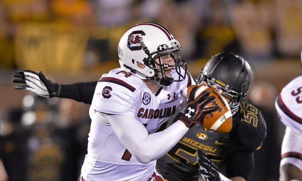 South Carolina quarterback Connor Shaw scrambles away from Missouri defensive lineman Shane Ray during the Gamecocks' 27-24 victory Saturday.