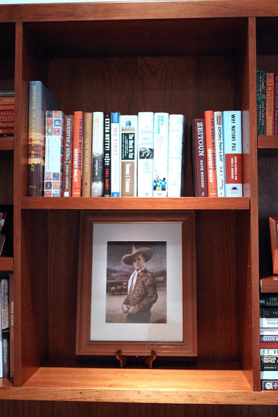 An image of cowboy actor Tim McCoy sits on a bookshelf of Janice Partyka and her husband Randy Hall, of La Canada Flintridge, in their home formerly owned by Inga Arvad and her husband Tim McCoy in La Canada Flintridge on Wednesday, October 23, 2013. Arvad had relationships with Adolf Hitler, and a young John F. Kennedy, and McCoy was a cowboy circus performer and an actor. Parkyka and her husband have become fascinated with their home's past and have done some historical digging to learn more about Arvad and McCoy.