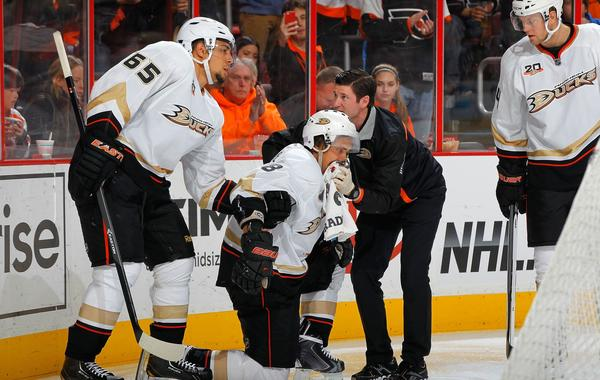 Ducks forward Teemu Selanne, center, is helped off the ice by a trainer Joe Huff and teammate Emerson Etem after taking a high stick to the mouth during Tuesday's 3-2 win over the Philadelphia Flyers.