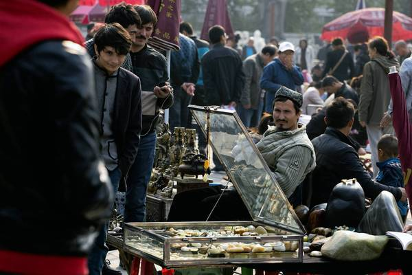 Uighurs sell their wares at a market in Beijing. Members of the ethnic minority said they were facing stepped-up scrutiny from Chinese police after the deadly car crash Monday at Beijing's Tiananmen Square.