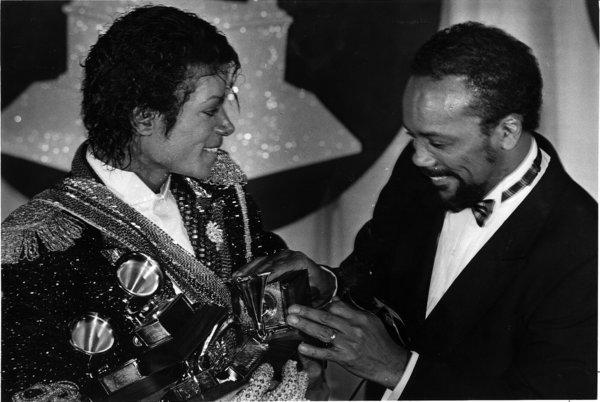 Michael Jackson, left, with Quincy Jones and an armful of Grammys at the awards show on Feb. 28, 1984.