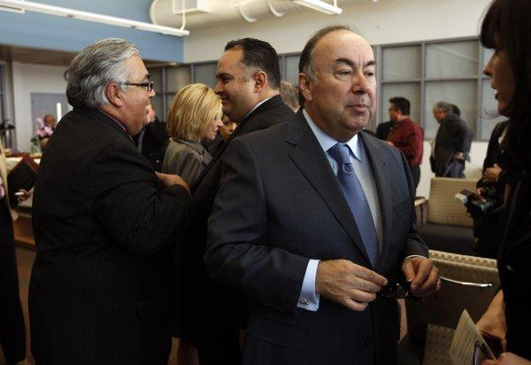 California state Sen. Ron Calderon, left, talks with California Assembly Speaker John Perez, while former state assemblyman Tom Calderon, center, talks with a friend.