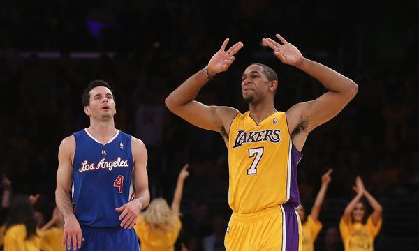 Clippers guard J.J. Redick, left, looks on as Lakers guard Xavier Henry celebrates during the fourth quarter of the Clippers season-opening loss Tuesday. Redick says the Clippers failed to execute on both sides of the ball against the Lakers.