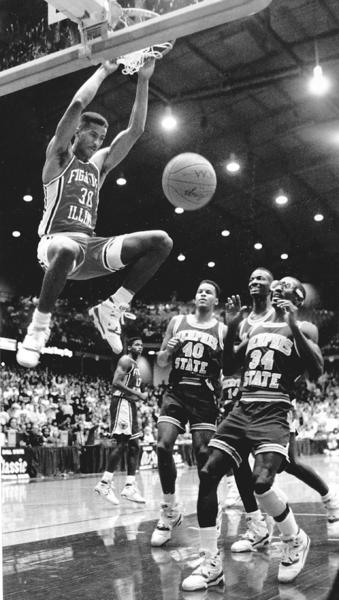 Illinois' Marcus Liberty dunks during the 1988-89 basketball season.