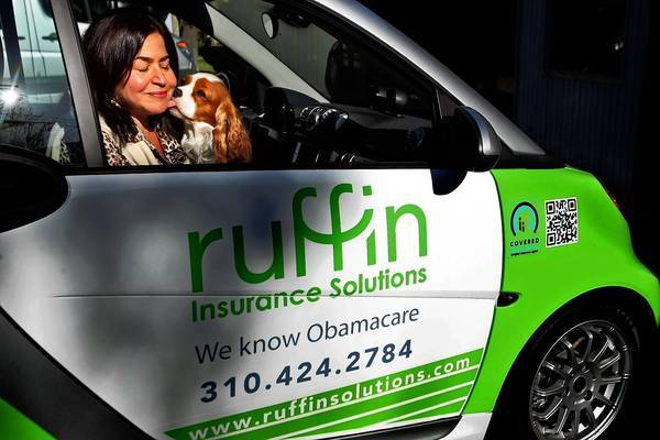 "Helena Ruffin, a health insurance agent in Venice, put Covered California's logo on her car to promote the exchange. Ruffin said she can't get her agent log-in to work for the state's enrollment system. ""We can't enroll anybody, and I have a list of customers who are ready."""