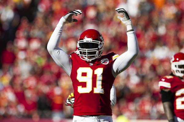 Outside linebacker Tamba Hali #91 of the Kansas City Chiefs attempts to pumps up the crowd on fourth down during the game against the Cleveland Browns at Arrowhead Stadium on October 27, 2013 in Kansas City, Missouri.