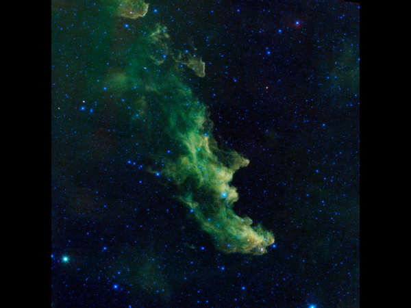 Massive plumes of gas create a wicked witch profile in the sky in this image taken by the WISE infrared telescope.