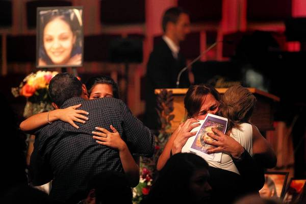 Family and friends comfort one another at the memorial service for Linda Valez on Oct. 5 in Wheaton. Valez had been homeless before her killing in September.