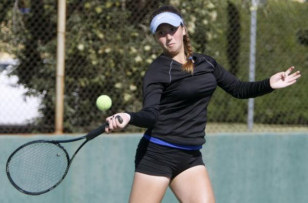 Burbank High singles player Lilit Vardanyan rallies en route to capturing a Pacific League singles championship on Wednesday afternoon at Pasadena High. (Raul Roa/Staff Photographer)