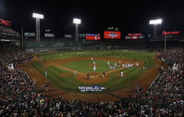 The Boston Red Sox run onto the field at Fenway Park after beating the St. Louis Cardinals in Game 6 of the World Series.