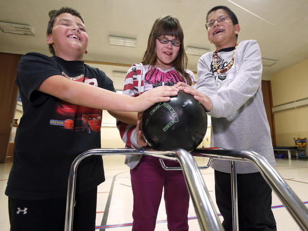 Blaine Jemming, 8, of Woonsocket, left, Hailey Heintzman, 10, of Aberdeen, center and Al'lyn Bear Stops, 10, of Iron Lightning, hope to have a ball as they and other students from the South Dakota School for the Blind and Visually Impaired take part in the Special Olympics Bowling Tournament at Village Bowl later this week. American News Photo by John Davis