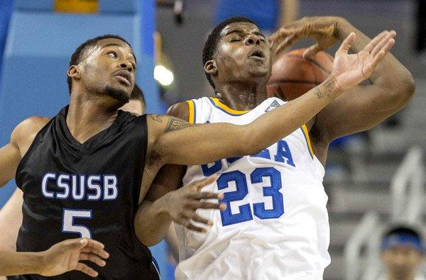 UCLA's Tony Parker (23) and Cal State San Bernardino's Donte Medder (5) battle for a loose ball in the first half Wednesday night.