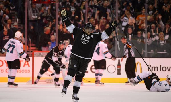 Kings center Anze Kopitar celebrates after scoring the winning goal in the Kings' 4-3 overtime victory over the San Jose Sharks on Wednesday.