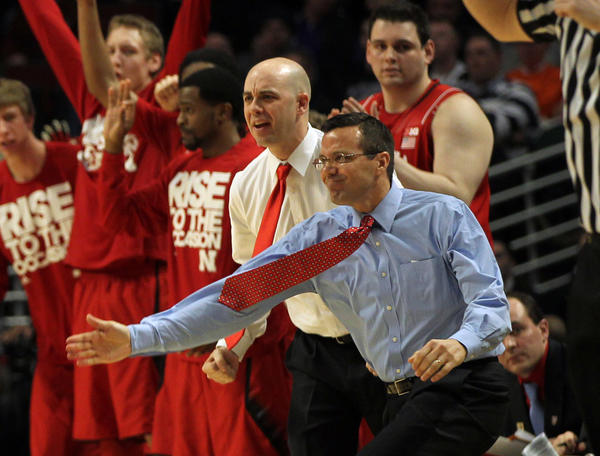 Nebraska head coach Tim Miles (right) and the Cornhuskers' bench react to Ray Gallegos' 3-pointer during 2nd half of team's 57-55 win over Purdue during first round of the Big Ten tournament last March.
