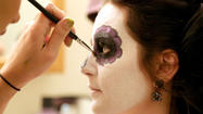 Halloween party-goers hire pro makeup artists to perfect their costumes
