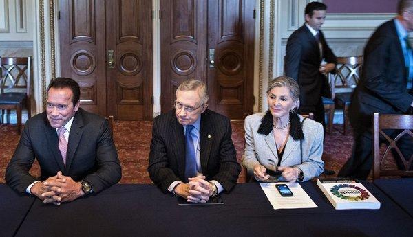 From left, actor and former California Gov. Arnold Schwarzenegger, Senate Majority Leader Harry Reid (D-Nev.) and Sen. Barbara Boxer (D-Calif.) take part in a meeting on Capitol Hill.