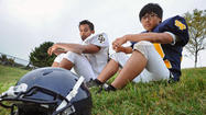 St. Paul's exchange students both fluent in football