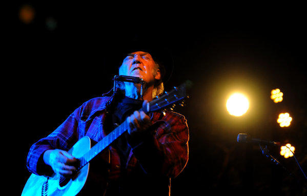 Neil Young performs at the annual fundraiser for the Silverlake Conservatory music school Thursday in Silver Lake along with the Red Hot Chili Peppers.