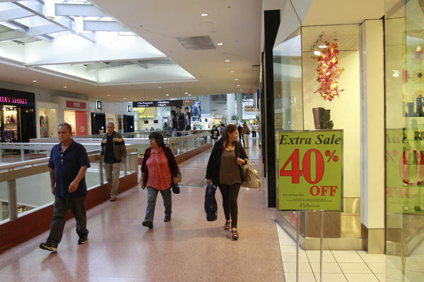 Shoppers browse the stores at the Westfield Santa Anita Mall on Oct. 29, 2013.