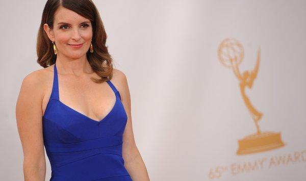 Tina Fey arrives on the red carpet for the 65th Emmy Awards. The funnywoman is returning to NBC with a new comedy she'll executive producer.