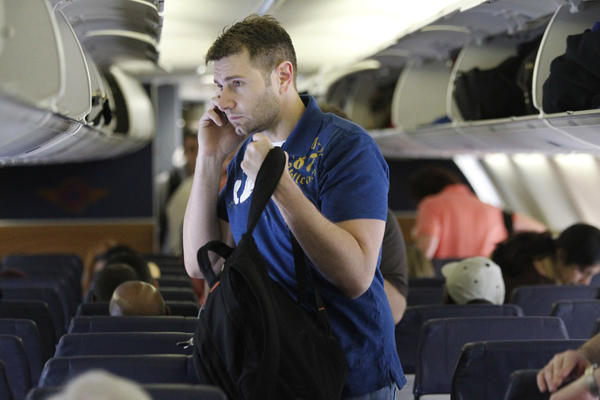 Airline passengers will continue to be unable to use their phones during takeoffs and landings, but soon will be able to continue reading their Kindles and playing on their iPhones.