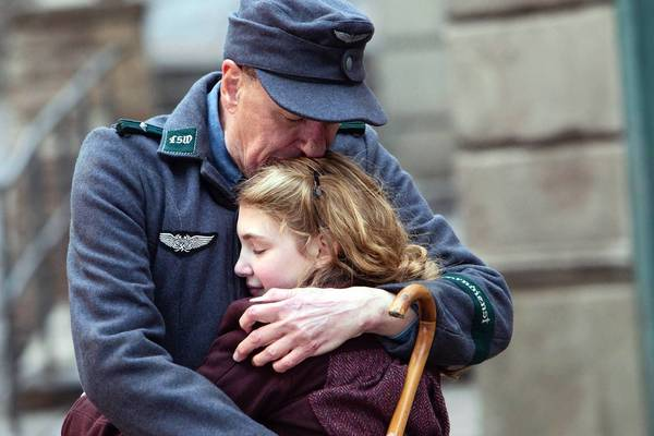 Liesel (Sophie Nélisse) and her foster father Hans (Geoffrey Rush) share a quiet moment.