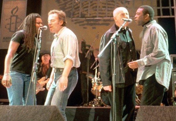 "Tracy Chapman, left, Bruce Springsteen, Peter Gabriel and Youssou N'Dour at the 1988 Amnesty International's ""The Struggle Continues..."" benefit concert in Paris."