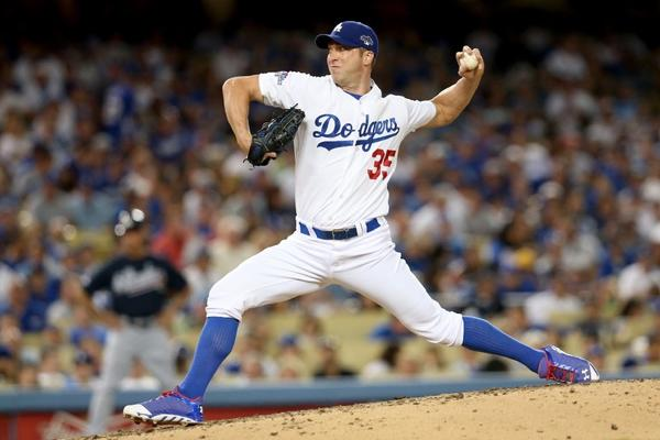 Chris Capuano pitches for the Dodgers in the fourth inning of Game 3 of the National League Division Series against the Atlanta Braves on Oct. 6.