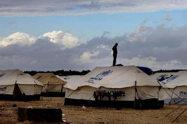 A Syrian refugee stands on top of a water tank at Zaatari refugee camp in Mafrag, Jordan near the Syrian border on Jan. 9.