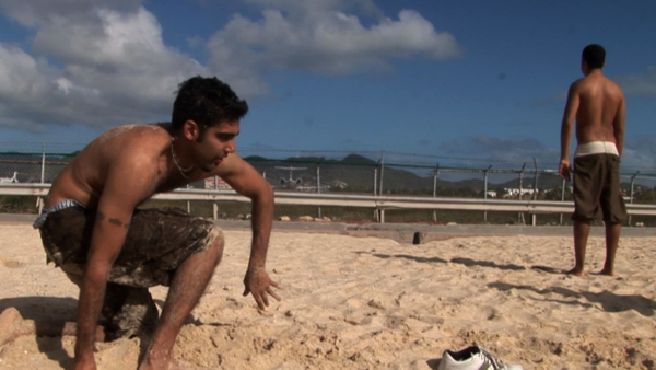 "Jason DaSilva on the beach with family in a scene from ""When I Walk."""