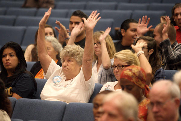 Supporters for a Sheriff's Department oversight commission are seen at a meeting at Kenneth Hahn Hall of Administration in Los Angeles.