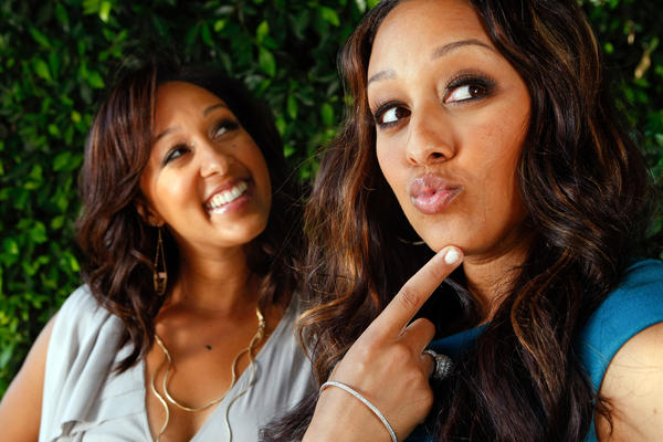 "Tamera Mowry-Mousley, left, shown with her identical twin, Tia, is one of the hosts of the daytime talk show ""The Real."""