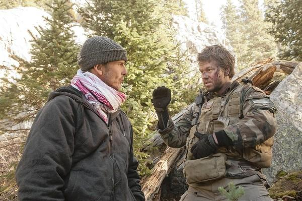 "Director Peter Berg, left, and Mark Wahlberg on the set of the movie ""Lone Survivor."""