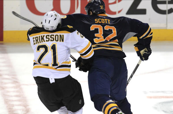 Buffalo left wing John Scott delivers a blow to the head of Bruins left wing Loui Eriksson during third period of their game last week.