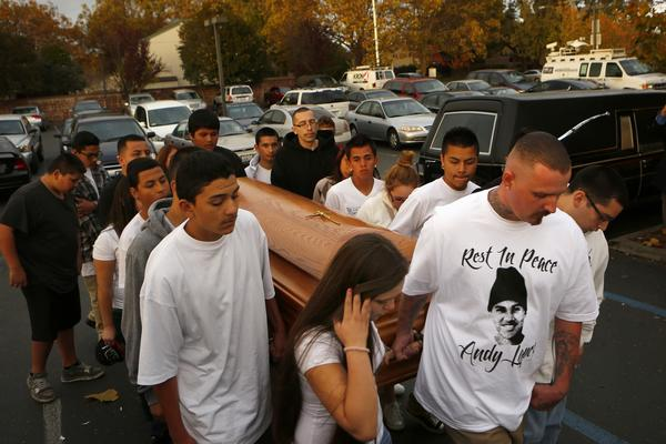 Friends of Andy Lopez carry his coffin into Resurrection Parish during his funeral ceremony in Santa Rosa on Tuesday, Oct. 29. Lopez was shot by a Sonoma County deputy who authorities say mistook a pellet gun Lopez was carrying for an assault rifle.